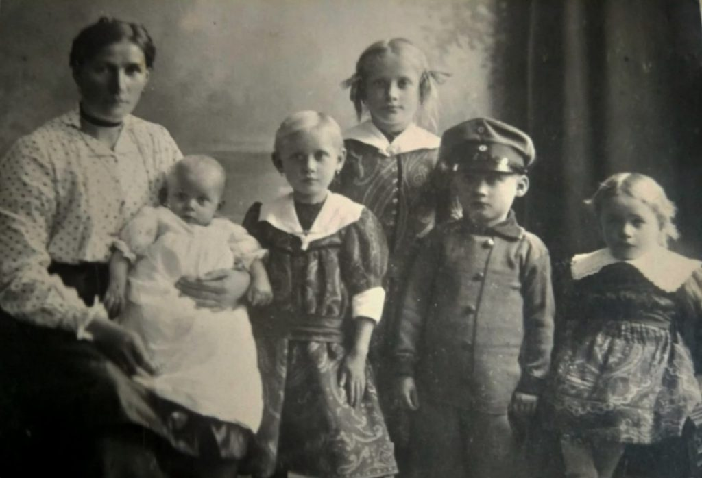 Family photo around 1918 (my grandfather standing in the right center of the picture)