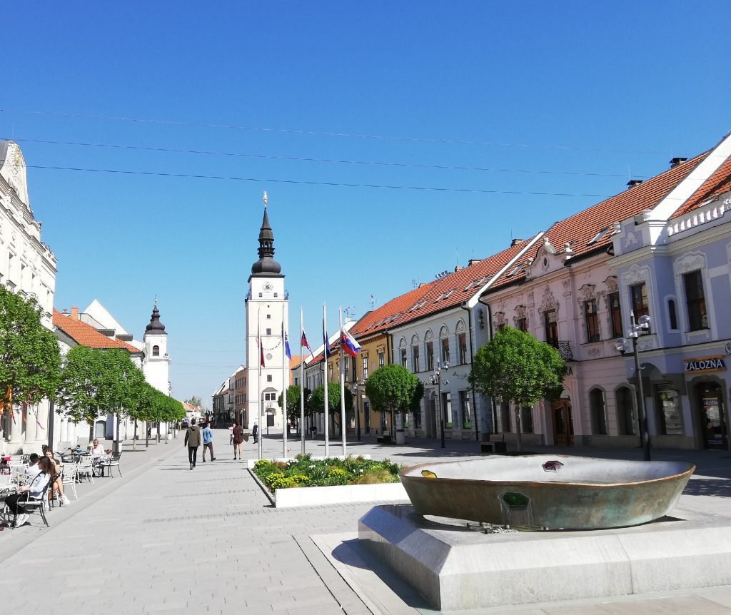 Hlavná street or main street (Square of the Holy Trinity with the City Tower (Mestská veža) in the center of the picture)