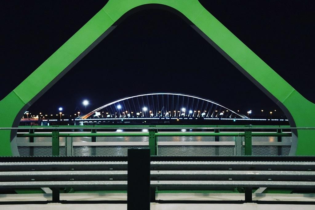Starý Most at night, view to the Apollo bridge downstream